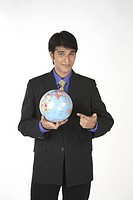 Executive holding globe in hand showing India MR687M
