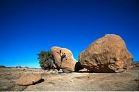 Man bouldering, Tafraoute, Morocco