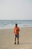 South Asian Indian young man doing morning activity running on seashore MR703D