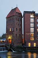 Historical storage tower and modern guest house, Bergstroem four-star hotel on the Ilmenau river, old town, Lueneburg, Lower Saxony, Germany, Europe