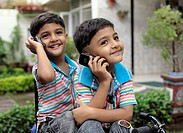 Twin brothers talking on mobiles , Jabalpur , Madhya Pradesh , India MR 372