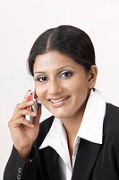 Corporate executive lady talking on mobile MR738