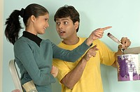 South Asian Indian young couple planning interior of their new flat MR 705_C & 705_D