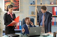 South Asian Indian businessmen and woman checking file and talking on phone in his office MR 670D , 670F ,670G