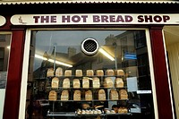 Loaves of bread and buns on display in a baker's shop window, Aberystwyth, Wales