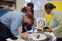 Ecorse, Michigan - Members of Americorps and other volunteers painted murals for the Ralph Bunche Academy, a public elementary school, during a Martin...