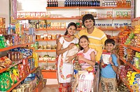 Parents and children with trolley shopping in supermarket MR748A,748B,748C,748D