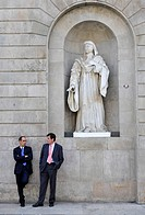 Government officials talking in front of a statue, seat of the Catalan regional government, Palau de la Generalitat, Plaça de Sant Jaume, Barcelona, C...