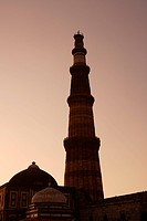 Sunset at Alai Darwaza Imam Zamins tomb and Qutab Minar built in 1311 red sandstone tower , Indo_Muslim art , Delhi sultanate , Delhi, India UNESCO Wo...
