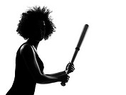 beautiful funny young afro american woman holding a baseball bat in silhouette shadow on studio isolated white backgroung
