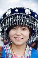 Woman wearing a decorative beaded hat, Dali, Yunnan Province, China