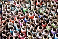Aerial view of reels of threads of various colors tailoring material , Pen , Raigad District , Maharashtra , India