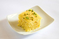 Indian cuisine , fast food Dhokla served in dish on white background