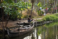Man fishing in a canal, Backwaters near Alleppey, Alappuzha, Kerala, India, South Asia, Asia