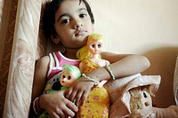 Young Indian little girl Srishti smiling with her dolls , Bombay Mumbai , Maharashtra , India MR542