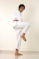 South Asian Indian teenager boy with brown belt_3 showing various kata , Bombay Mumbai , Maharashtra , India MR 310