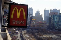 A Mc Donnalds store before a construction site in the city centre of the city of Shenzhen to the north of Hong Kong in the province Guangdong in Centr...