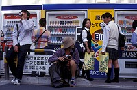 People before drinks machine in the city of Tokyo in Japan in Asia.