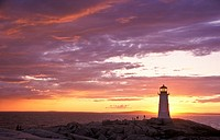 Peggys Cove Lighthouse Silhouetted at Sunset