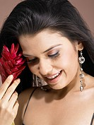 South Asian Indian woman holding ginger flower and smiling MR 702