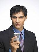 South Asian Indian executive man holding mobile phone MR