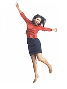 South Asian Indian executive woman jumping with joy MR