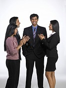 South Asian Indian executive men and women clapping MR