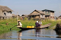 Village scene on the waterway, women in canoes talking to each other, Mang-Thawk, Inle Lake, Shan State, Myanmar, Southeast Asia, Asia