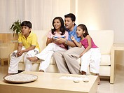 Children with parents watching TV sitting in house MR702R,MR702S,MR702T,MR702U