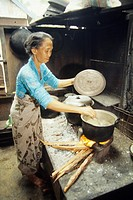woman cooking, Sumbawa island, Lesser Sunda Islands, Republic of Indonesia, Southeast Asia and Oceania