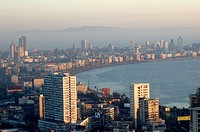 Aerial view of central Mumbai city at evening time showing Marine drive queens necklace and building , Bombay Mumbai , Maharashtra , India