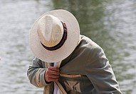 Student spectator in panama hat and old college blazer during Oxford University Eights Week rowing competition, Oxford, England, UK