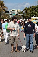 Pets tourists walking in Ocean Dr, Miami Beach, Florida, USA