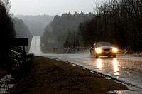 Car driving through a down pour, Algonquin Park, Ontario, Canada