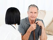 Retired man with his nurse at home