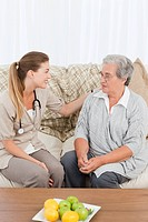 Nurse talking with her patient at home