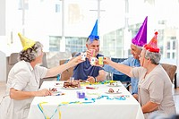 Mature friends on birthday at home