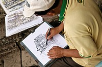 Draftsman in the Bayon, Angkor Thom temple complex, Siem Reap, Cambodia, Southeast Asia