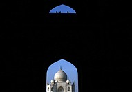 Taj Mahal seen from main entrance gate where some pigeon resting The Taj Mahal sometimes called ´the Taj´ was built by Emperor Shah Jahan in memory of...