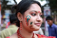 A young lady gets her face painted welcoming the Bangla New Year 1417, or Pohela Baishak Noboborsha or the Bangla New Year celebrates by all Banglades...