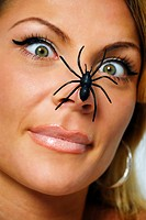 Spider on a woman's nose, arachnophobia