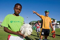 Coach instructing players at the Old Mutual Football Academy, Cape Town, South Africa