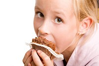 Girl eating a muffin