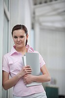 portrait of young woman holding files