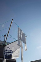 white clothes hanging on clothesline