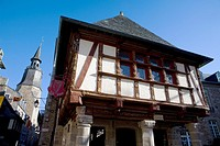 Typical house and Tour de l´Horloge or Clock Tower, in the old town of Dinan, in Cotes d´Armor department, Brittany  France