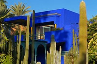 Islamic Art Museum of Marrakech at Majorelle Garden with cactus and palms