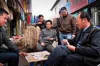 Men playing cards, Muxiyuan textile market, Fengtai District, Beijing, China, Asia