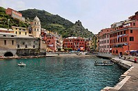 Harbor view with boat and colorful buildings in the village of Vernazza in the Cinque Terre region of Italy