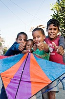 Boys playing with a kite showing thumbs up to the camera, Santiago de Cuba, Cuba, Caribbean